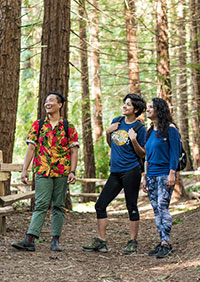 Amanda Machado (center) visits Redwood Regional Park in Oakland with friends