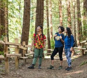 Amanda Machado (center) visits Redwood Regional Park in Oakland with friends