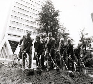 First tree planted in Transamerica Pyramid Redwood Park, June 12, 1973. [John Chase, VP Corporate Relations, Transamerica Corp.; Tony Guzzardo, Anthony M. Guzzardo & Assoc., Landscape Architect; John Dewitt, Secretary, Save the Redwoods League; Newton B. Drury, President, Save the Redwoods League; Leo Hewlett, President, California Redwood Association; Keith Lanning, Exec. VP, California Redwood Association.] Photo: Action Photo Service. Save the Redwoods League photograph collection [graphic], BANC PIC 2006.030--PIC, Carton 8. Courtesy of The Bancroft Library, University of California, Berkeley.