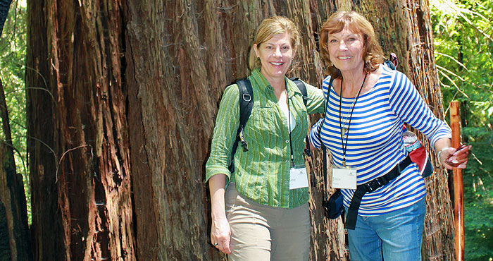 Tamara Pabis, left, and Joyce Harris enjoy a day in the redwood forest. Harris is helping to protect the future of our redwood forests by naming the League in her estate plan.