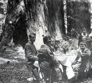 In 1926, John D. Rockefeller, Jr. discusses redwoods conservation with Save the Redwoods League leader Newton Drury. David Rockefeller is pictured on the front, right side.
