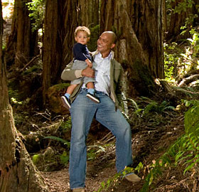 League Councilor Blake Williams shares his enthusiasm for the redwoods with his child. Photo by Paolo Vescia