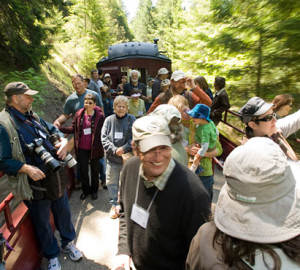 Your gifts helped to repair a collapsed railroad tunnel that shut down the Skunk Train's famous Redwood Route to the Noyo River Redwoods, which you protected. Smiles have returned to riders' faces, as in this 2011 image. Photo by Paolo Vescia