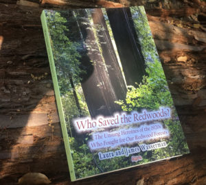 Book cover of Who Saved the Redwoods? The Unsung Heroines of the 1920s Who Fought for Our Redwood Forests by Laura and James Wasserman. The book is resting on a redwood log.